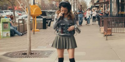 One-Woman Band Creates Entire Song While Casually Strolling Down theStreet