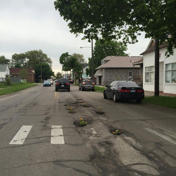 planting flowers in potholes 2 People are Planting Flowers in Potholes Because Cities Arent Fixing Them