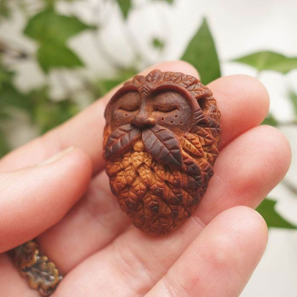 avocado stone faces carved by jan campbell 6 Waste Not, Want Not: Artist Carves Avocado Pits Into Tiny Forest Spirits