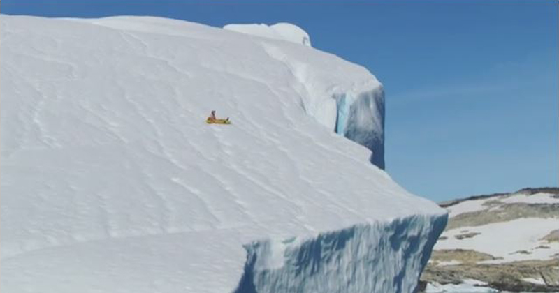 Lunatic Rides Inflatable Pizza Slice Off 300 ft Iceberg in Greenland