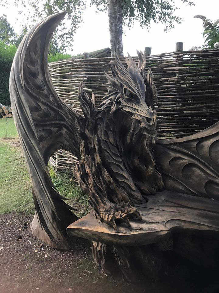 Check out this insane dragon bench carved by a chainsaw fizx