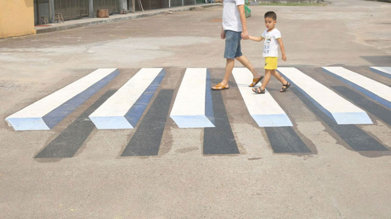 cities around the globe are testing 3d crosswalks to slow. Black Bedroom Furniture Sets. Home Design Ideas