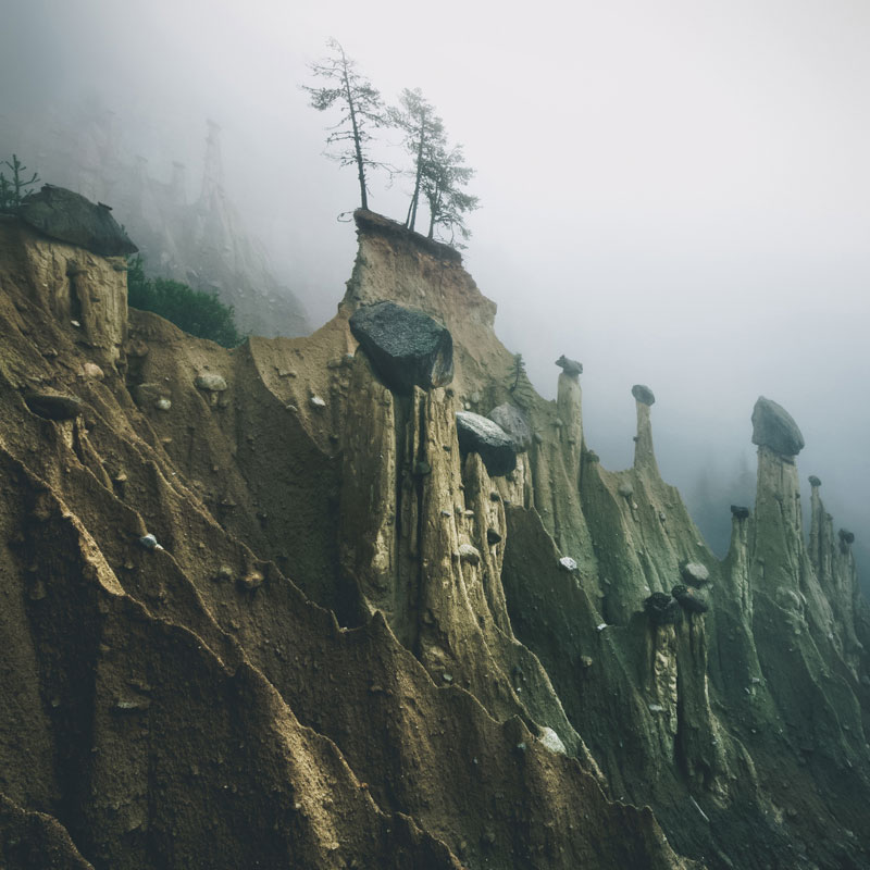 earth pyramids of south tyrol kilian schonberger otherworld 1 The Earth Pyramids of Italy: Where Boulders Perch Atop Pillars of Clay