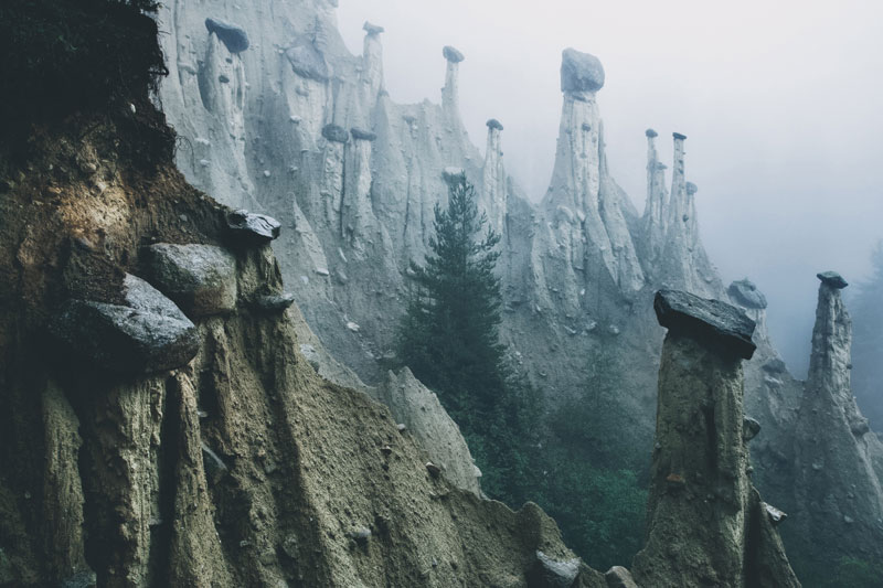 earth pyramids of south tyrol kilian schonberger otherworld 10 The Earth Pyramids of Italy: Where Boulders Perch Atop Pillars of Clay