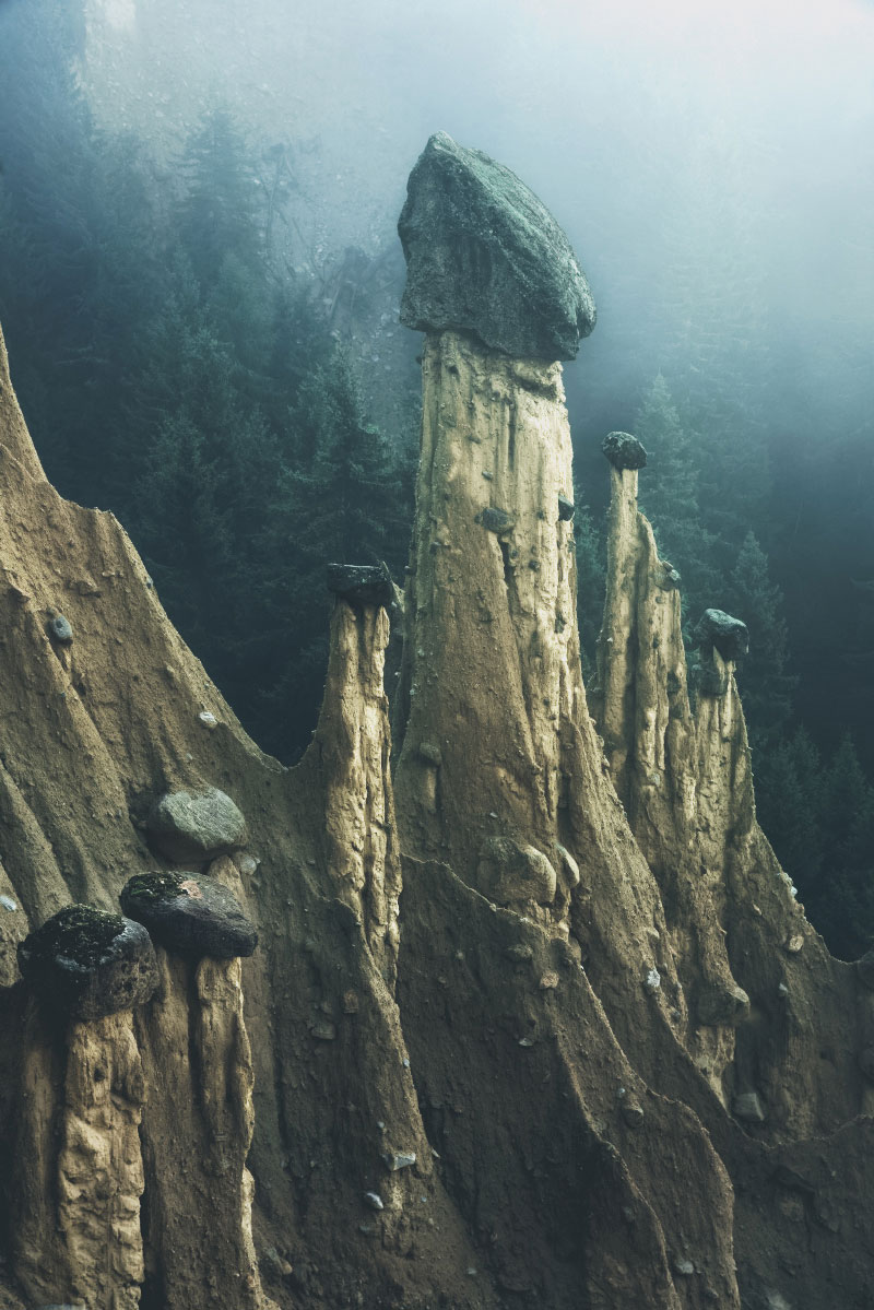 earth pyramids of south tyrol kilian schonberger otherworld 8 The Earth Pyramids of Italy: Where Boulders Perch Atop Pillars of Clay