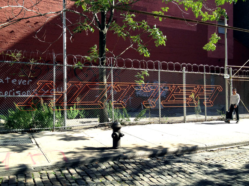 street artist hot tea yarn fence 3d letters 5 This Artist Uses Yarn to Create Amazing 3D Letters on Chain Link Fences