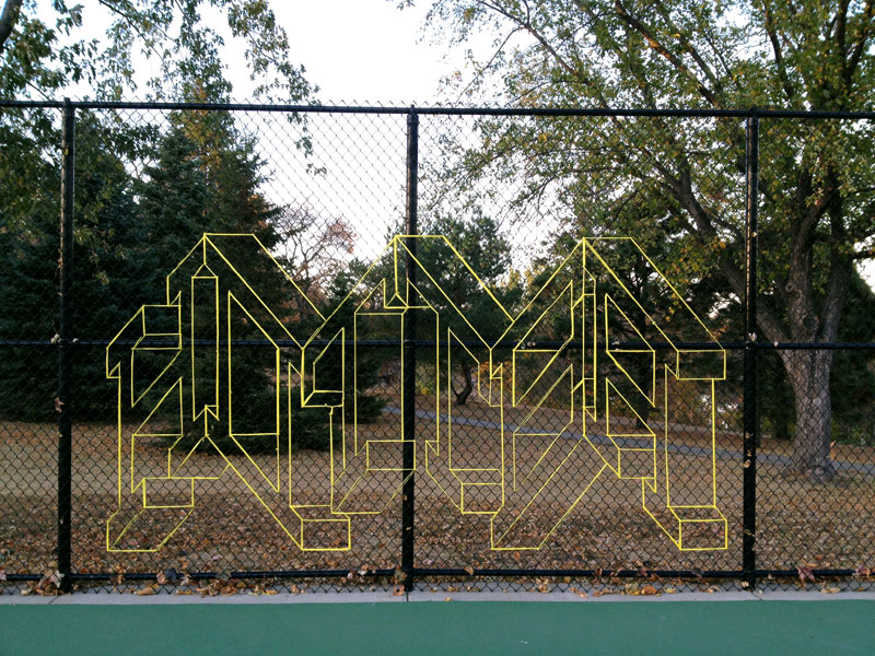 street artist hot tea yarn fence 3d letters 6 This Artist Uses Yarn to Create Amazing 3D Letters on Chain Link Fences