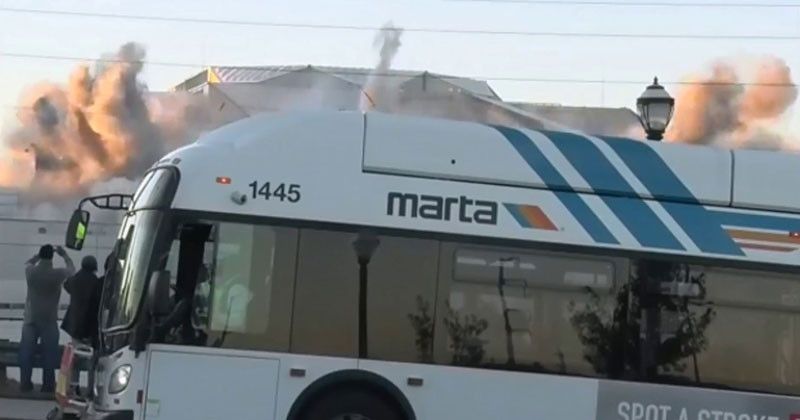 cameraman loses mind live as bus perfectly blocks building