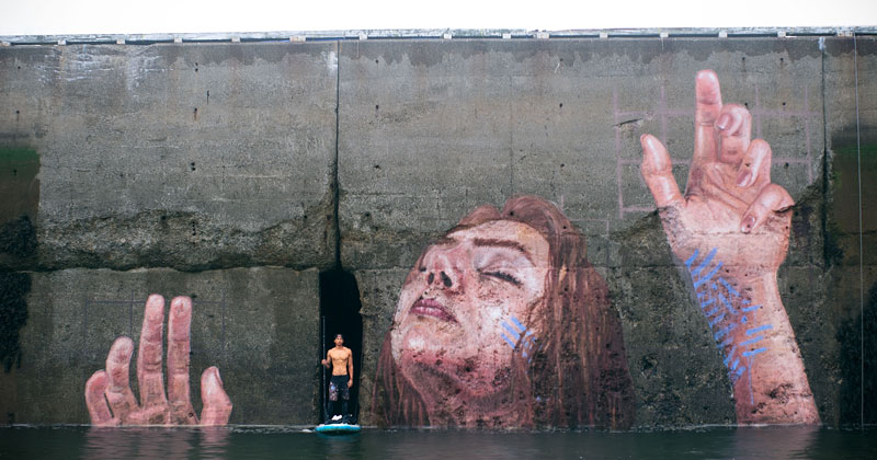 mural goes up and down with tide saint john new brunswick canada bay of fundy by hula (1)twistedsifter