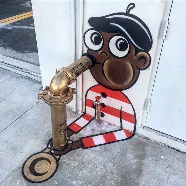 tom bob street art 4 Street Artist Tom Bob Adds Color to Mundane Objects Around Town