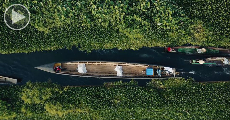 Drone Captures Boat Traffic Through Floating Gardens and Villages from Above