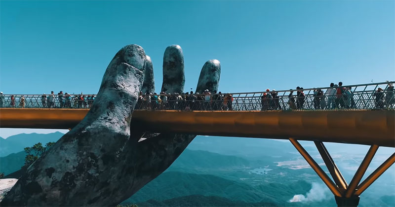 giant hands holding up golden bridge on ba na hills da nang vietnam 3 Giant Hands Raise Bridge in Vietnam to the Sky