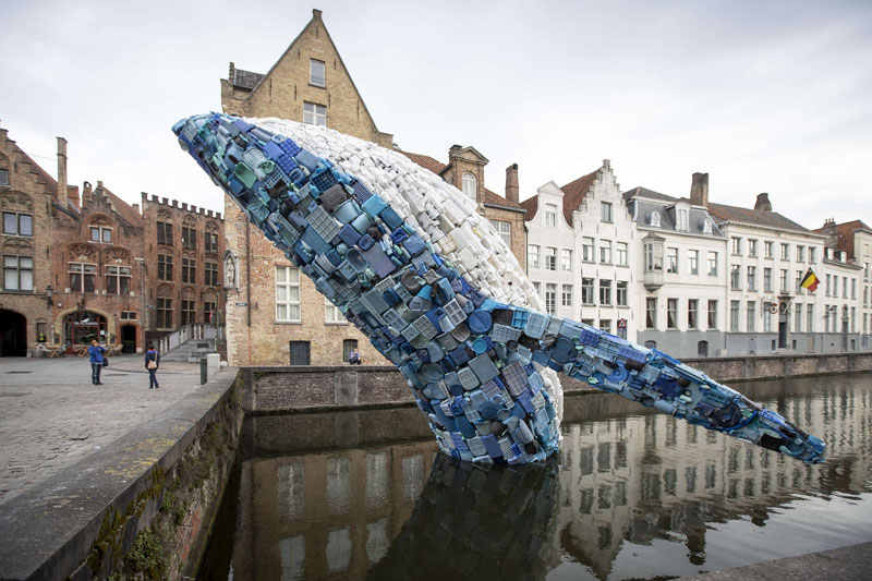 giant whale made from 10000 pounds of plastic ocean waste by studiokca bruges triennial 8 A 38 ft Tall Breaching Whale Made From 10,000 Pounds of Plastic Ocean Waste