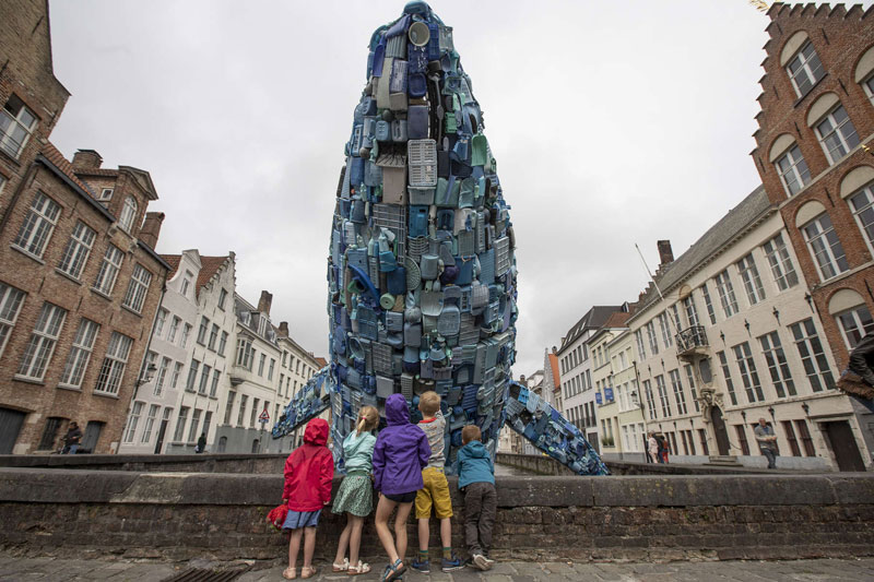 giant whale made from 10000 pounds of plastic ocean waste by studiokca bruges triennial 9 A 38 ft Tall Breaching Whale Made From 10,000 Pounds of Plastic Ocean Waste