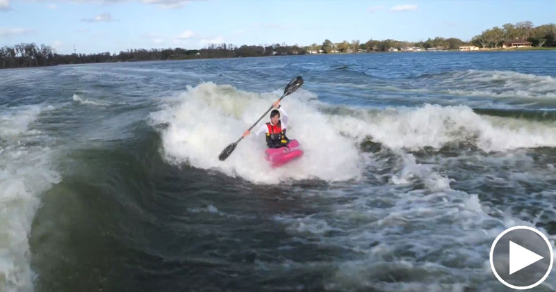 Just a Guy Kayaking Behind Two WakeboardBoats