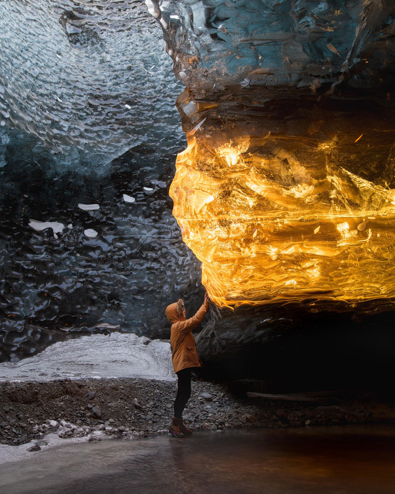 setting sun turns ice cave in iceland into amber by sarah bethea Setting Sun Turns Ice Cave in Iceland Into Amber