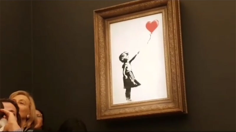 banksy shredder auction 6 Banksy Artwork Self Destructs after Selling for $1 Million at Auction