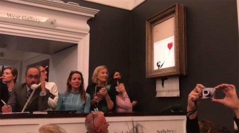banksy shredder auction 7 Banksy Artwork Self Destructs after Selling for $1 Million at Auction