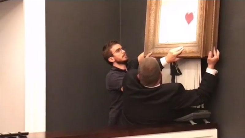 banksy shredder auction 8 Banksy Artwork Self Destructs after Selling for $1 Million at Auction