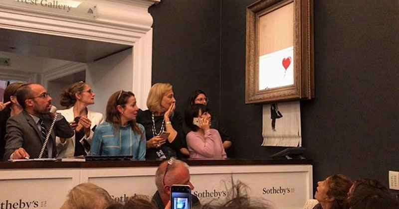 banksy shredder painting at auction Banksy Artwork Self Destructs after Selling for $1 Million at Auction