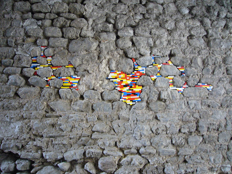 filling holes and cracks in walls with lego jan vormann 1 People Around the Globe Are Filling Cracks With LEGO (10 Photos)