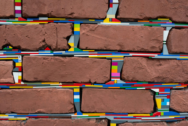 people around the globe are filling cracks with lego 10 photos