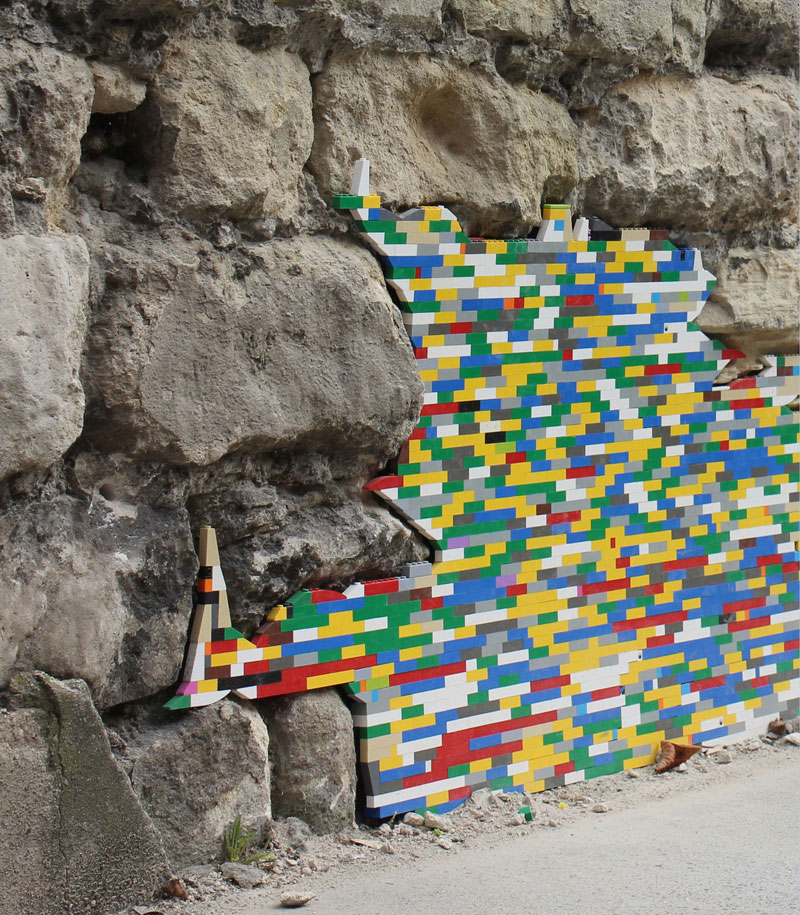 filling holes and cracks in walls with lego jan vormann 7 People Around the Globe Are Filling Cracks With LEGO (10 Photos)