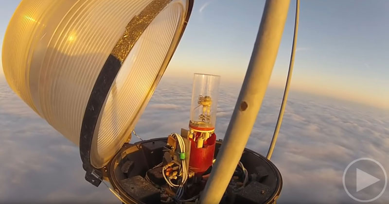 Changing a Bulb Atop a 2000 Ft Tower Looks As Crazy As It Sounds