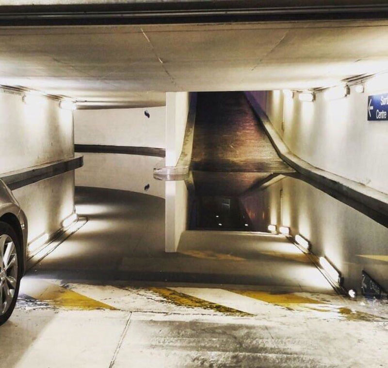I Can Admit I Needed Some Help With This Surreal Parking Garage Puddle