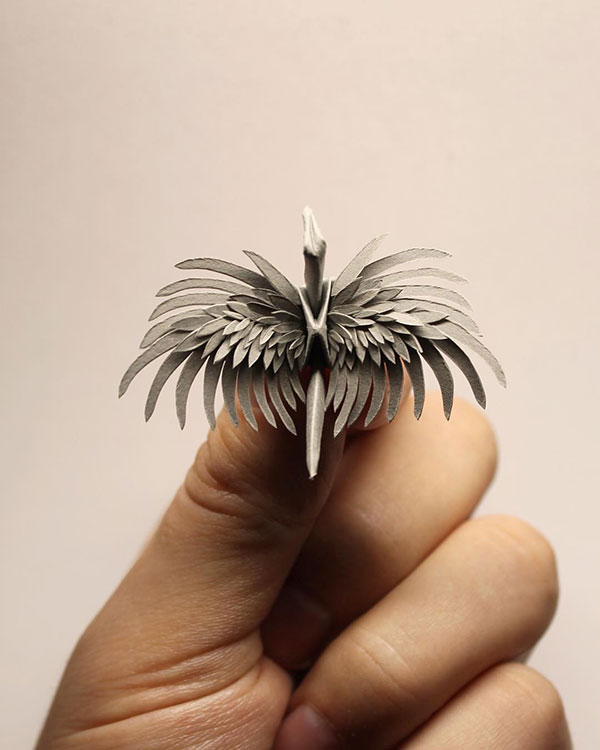 paper crane decorations by cristian marianciuc 6 Paper Artist Folds Cranes and Then Gives Them Intricate Decorations