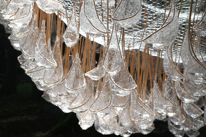 a giant chandelier in the forest made from tiny rainwater catchers 5 A Giant Chandelier in the Forest Made From Tiny Rainwater Catchers