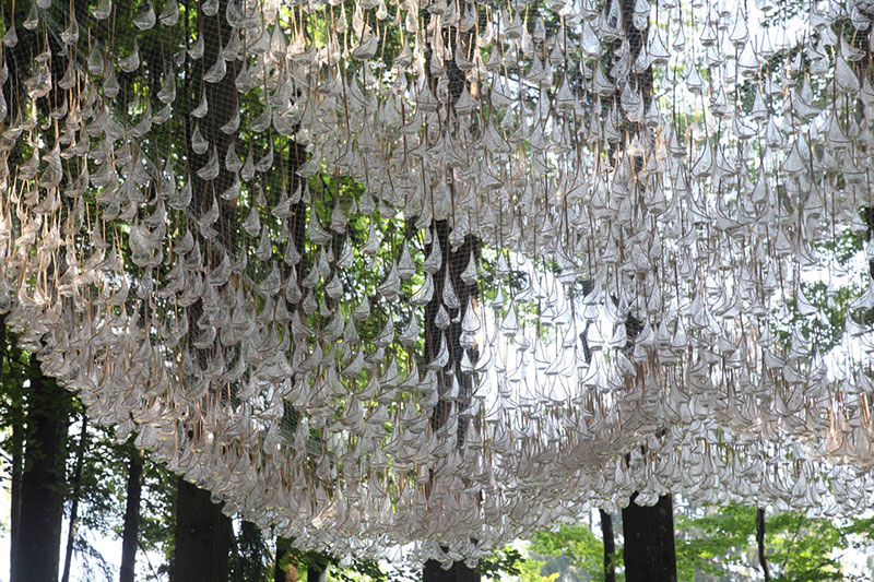 a giant chandelier in the forest made from tiny rainwater catchers 8 A Giant Chandelier in the Forest Made From Tiny Rainwater Catchers