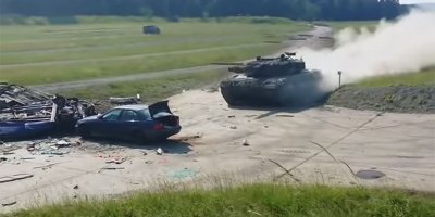 A Stationary Vehicle Versus a Tank at FullSpeed