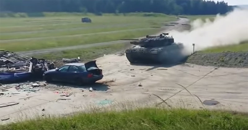 A Stationary Vehicle Versus a Tank at Full Speed