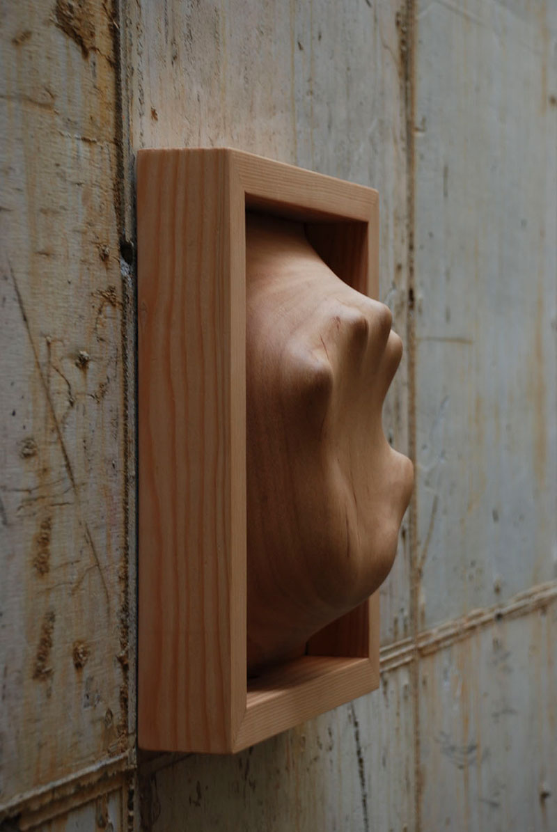 trapped in wood sculptures carved by tung ming chin 6 Trapped in Wood: Haunting Sculptures Carved by Tung Ming Chin