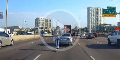 Guy on Rented Scooter Crosses 5 Highway Lanes WearingHeadphones