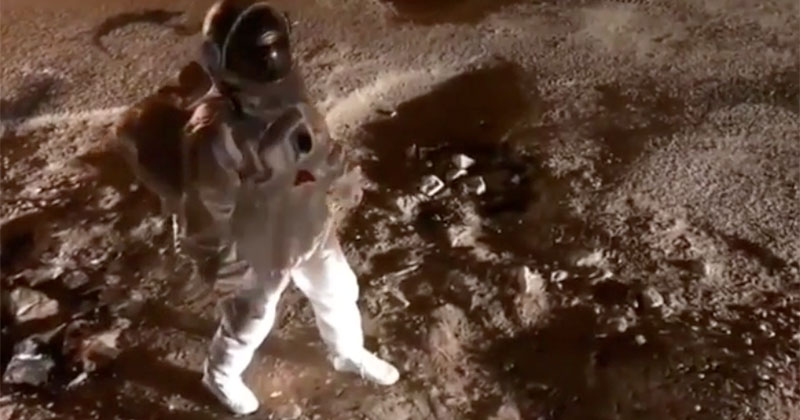 Guy Fakes Walking on the Moon in Protest of Giant Potholes on theRoad