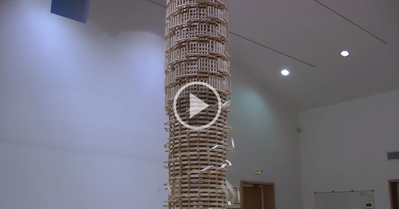 Toppling a Giant Domino Tower 2 Stories High