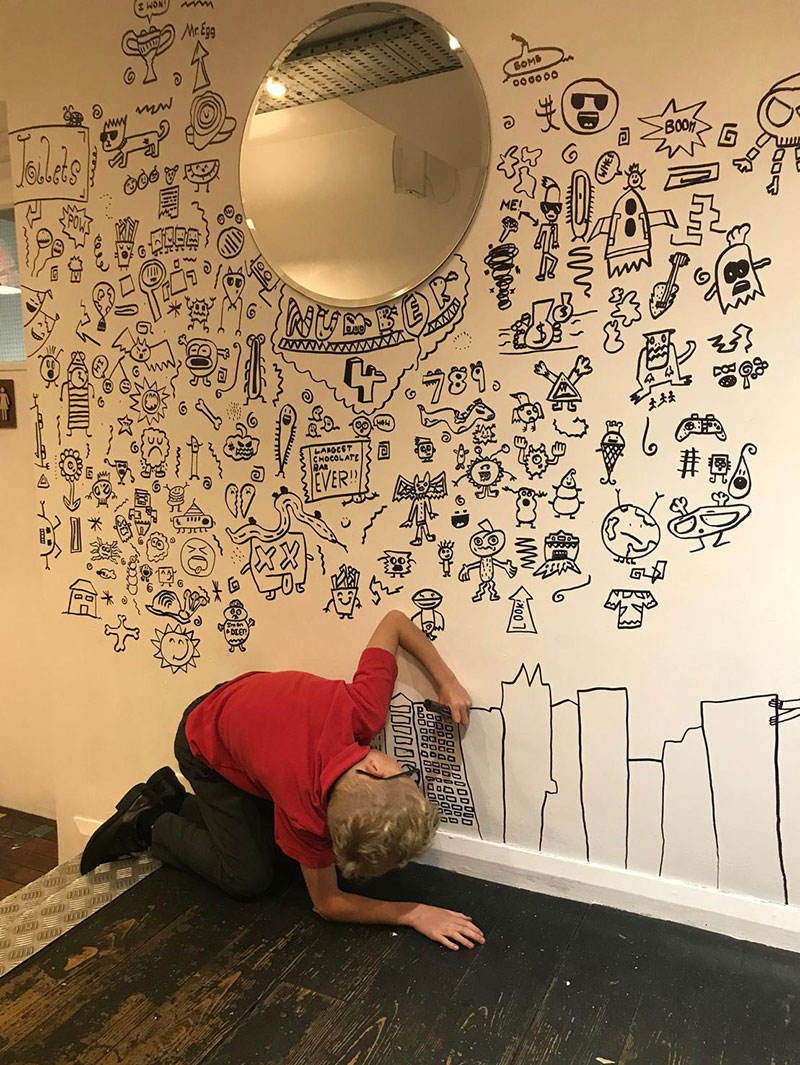 kid told not to doodle in class gets hired by local restaurant to decorate their walls 22 Kid Told Not to Doodle in Class Gets Hired by Local Restaurant to Decorate Their Walls