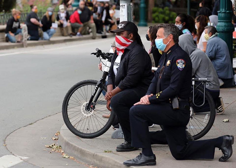police officers are standing kneeling marching in solidarity 1 Across the Country, a Few Brave Police Officers are Standing in Solidarity