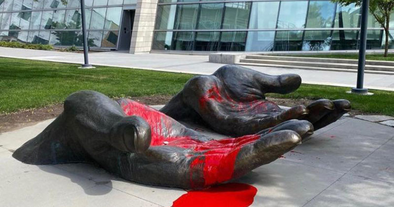 Red Paint Completely Changed This 'Serve and Protect' Sculpture During the Protests