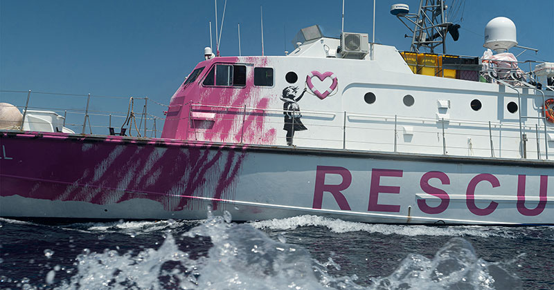 Banksy Uses Art Sales to Fund High Speed Lifeboat and Rescue Refugees Stranded at Sea