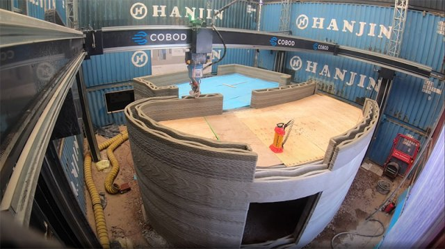 this 3d concrete printer just printed this two story house on site 7 This 3D Concrete Printer Just Printed a Two Story House On Site